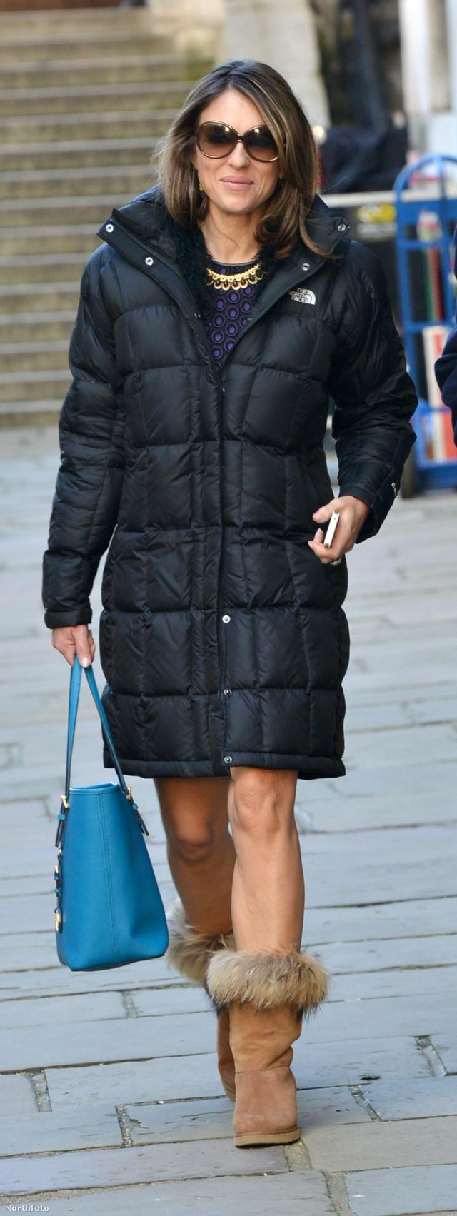 Úgy tűnik, hogy a londoniak még télen sem érzik szükségét a harisnyának. Elizabeth Hurley is beérte egy meleg kabáttal és egy szőrmés csizmával.