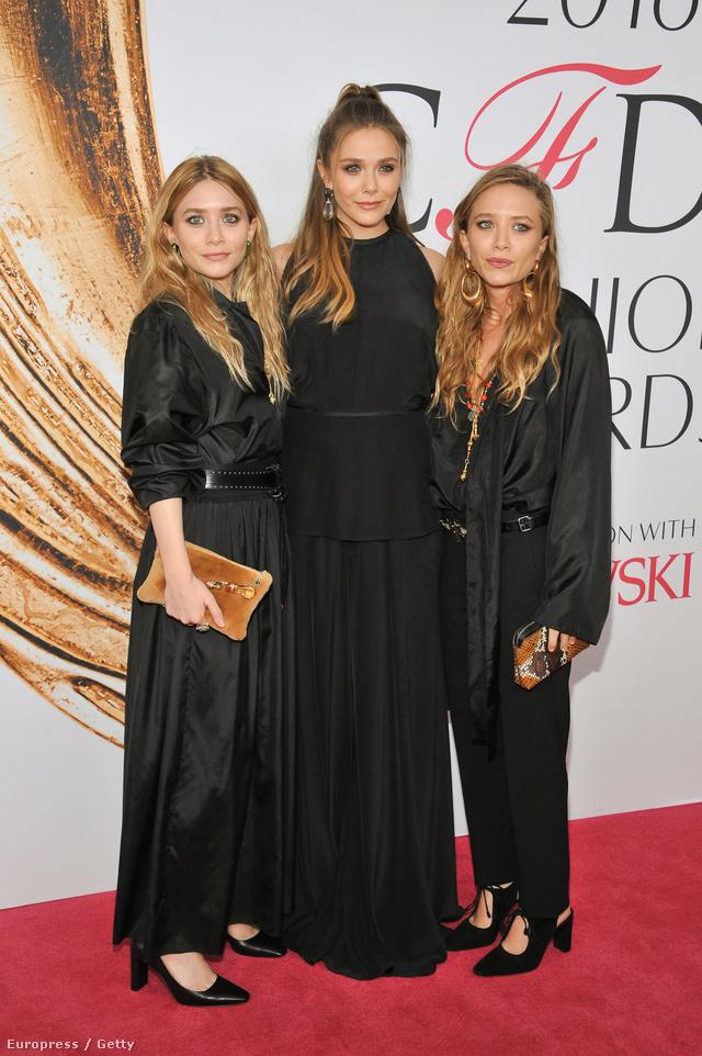A szomorkodó Olsen-testvérek tetőtől-talpig feketében.