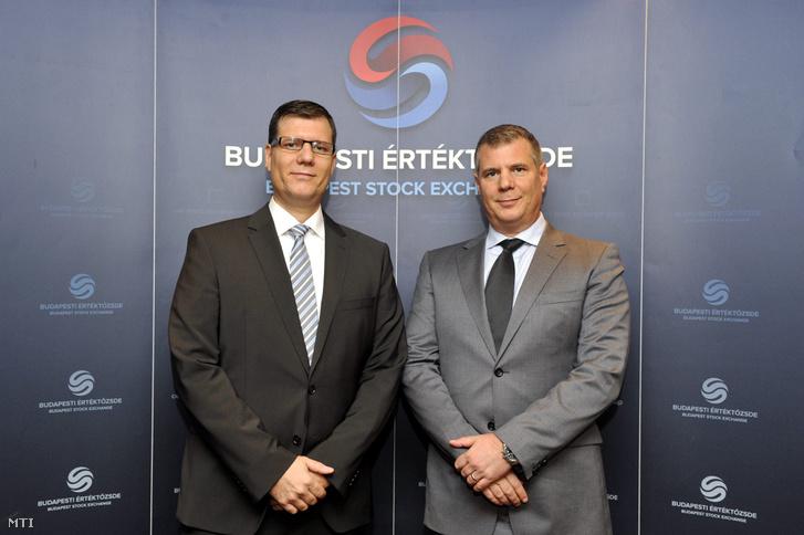 Doron (b) és Guy Dymschiz a Duna House csoport társ-vezérigazgatói és alapító társtulajdonosai a csoport és a Budapesti Értéktőzsde sajtótájékoztatóján a budapesti BankCenterben 2015. november 2-án.