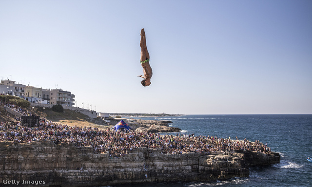 Red Bull Cliff Diving World Series 2015                         Caption:POLIGNANO A MARE ITALY - SEPTEMBER 12:  (EDITORIAL USE ONLY) In this handout image provided by Red Bull Jonathan Paredes of Mexico dives from the 27.5 metre platform during the seeding round of the seventh stop of the Red Bull Cliff Diving World Series Polignano a Mare Italy. (Photo by Romina Amato/Red Bull via Getty Images)