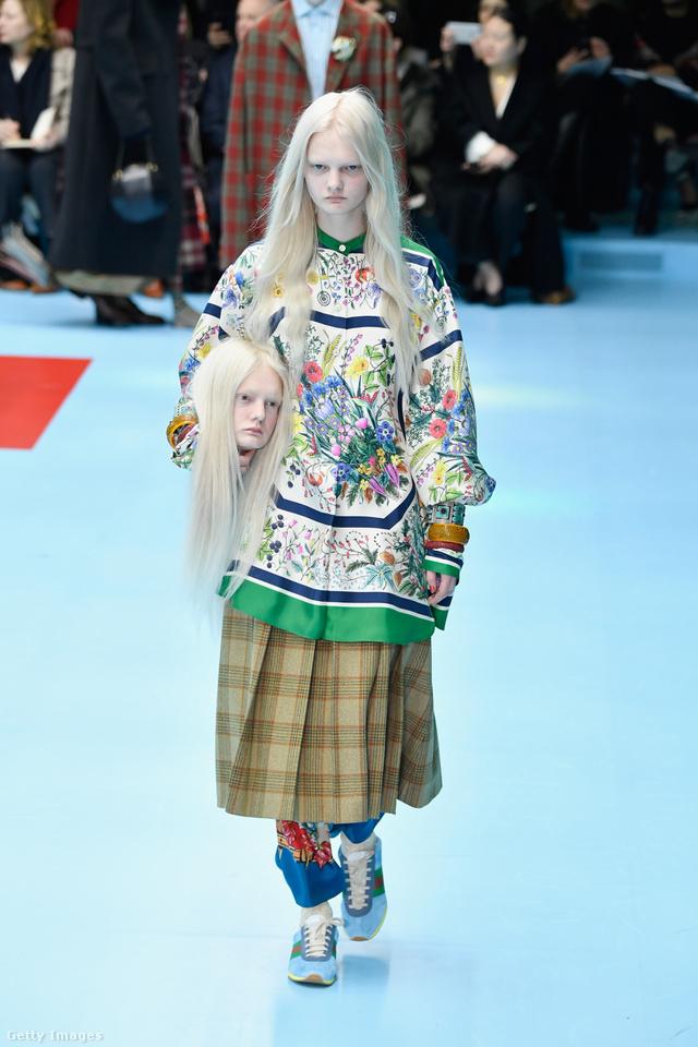 A saját fejének mását tartja a Gucci modellje a kezében.