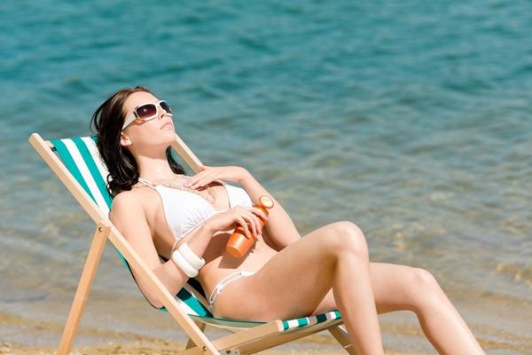 stockfresh id959901 summer-young-woman-sunbathing-in-bikini-sunc