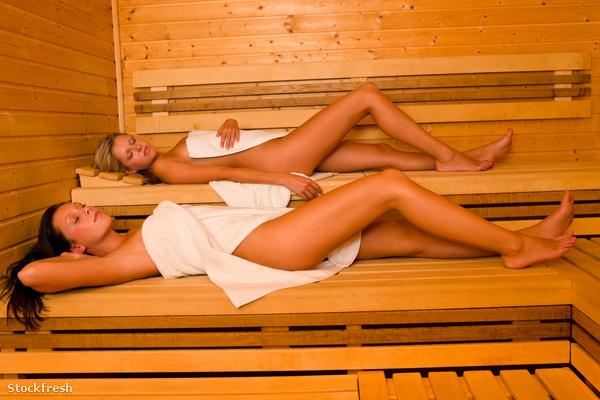stockfresh 1162737 sauna-two-women-relaxing-lying-wrapped-towel