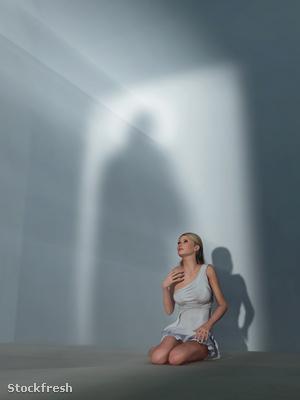 stockfresh 710276 praying-woman-in-dark-room sizeM