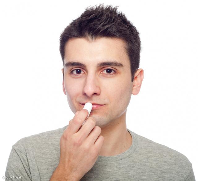 stockfresh 723638 young-man-applying-lip-balm sizeM