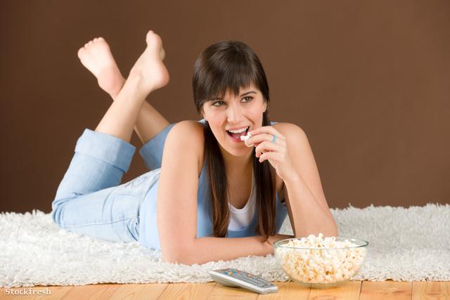 stockfresh 836102 woman-teenager-watch-television-eat-popcorn si