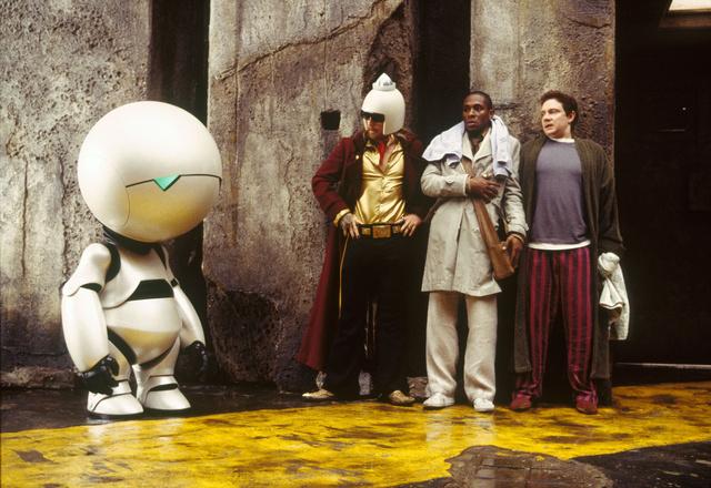 A Galaxis Útikalauz Stopposoknak főszereplői: Marvin, a robot, Zaphod Beeblebrox, Ford Prefect és Arthur Dent.