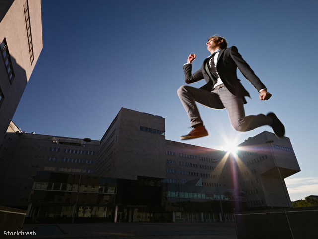 stockfresh 1602391 businessman-jumping-and-smiling-outside-offic