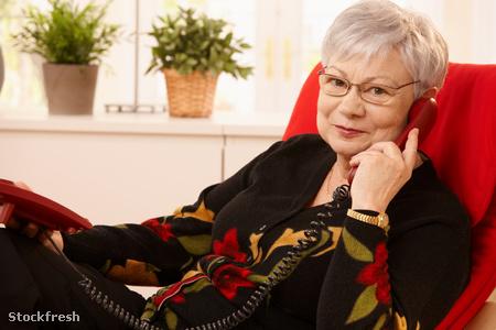 stockfresh 101209 senior-lady-using-landline-phone sizeM
