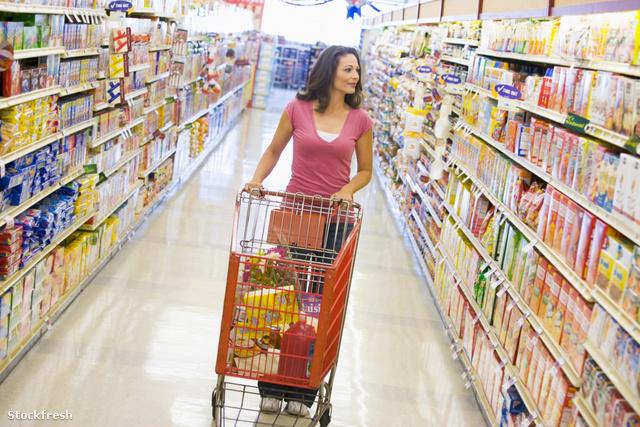 stockfresh 82765 woman-pushing-trolley-along-supermarket-aisle s