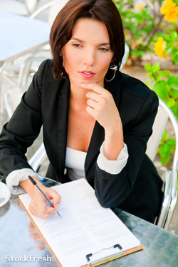 stockfresh 1506223 business-woman-working-with-documents-while-h