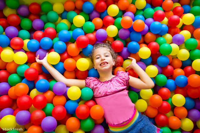 stockfresh 1229947 child-girl-on-colorful-balls-playground-high-