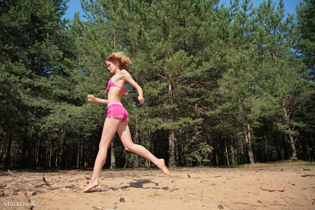 stockfresh 1207090 young-girl-runs-on-sand-in-wood sizeM