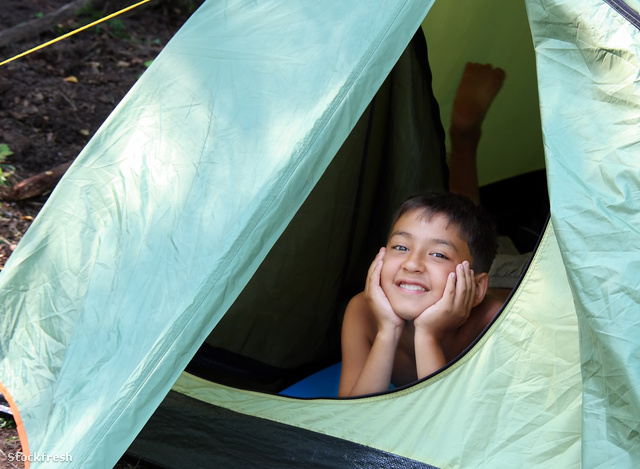 stockfresh 604309 smiling-boy-looking-from-tent sizeM