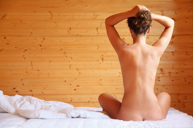 stockfresh 645449 naked-beautiful-hot-woman-sitting-on-bed-in-co