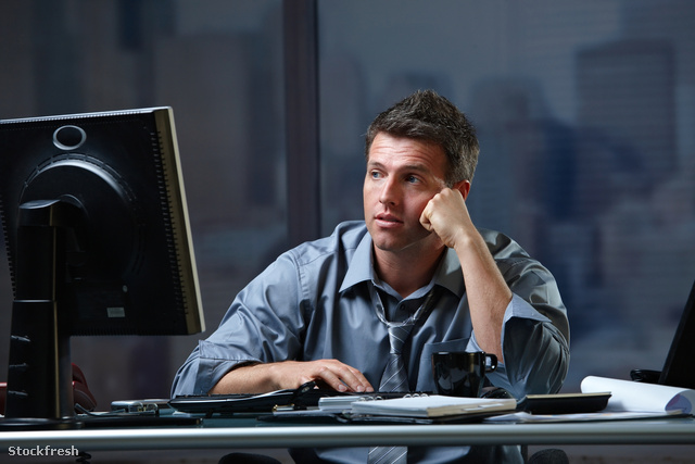 stockfresh 74115 tired-professional-looking-at-screen-troubled s