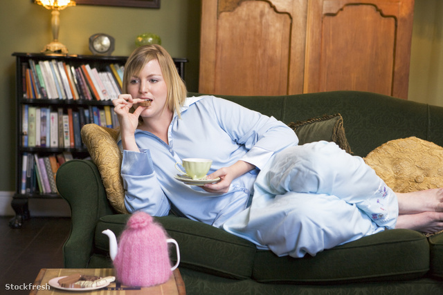 stockfresh 85599 a-young-woman-lying-on-her-couch-drinking-tea s