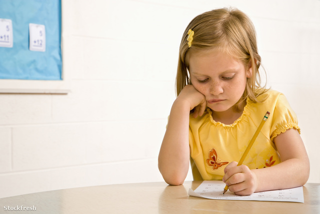 stockfresh 29032 young-girl-in-classroom-writing-on-paper sizeM