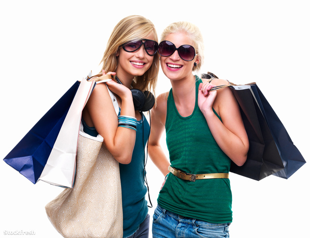 stockfresh 63597 happy-young-girls-standing-with-shopping-bags s