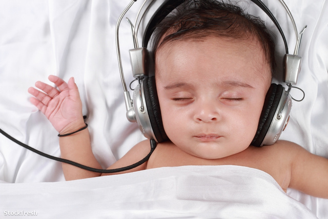stockfresh 1769931 2-month-old-baby-listening-to-music-with-head