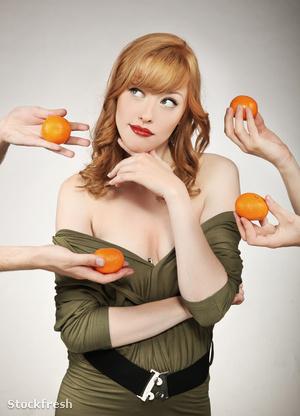 stockfresh 698343 beautiful-woman-making-a-fruit-choice sizeM