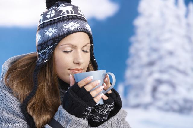stockfresh 624069 pretty-girl-drinking-hot-tea-in-winter-eyes-cl