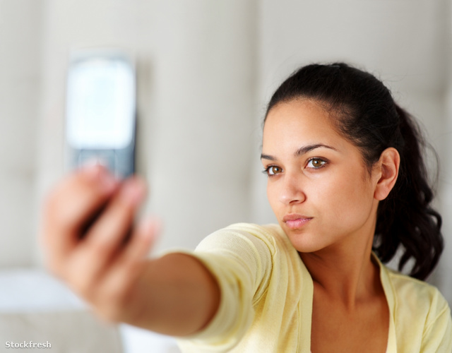 stockfresh 1175507 cute-young-woman-taking-picture-through-mobil
