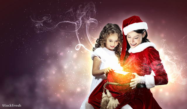 stockfresh 2151571 little-girl-with-christmas-gifts-and-santa si