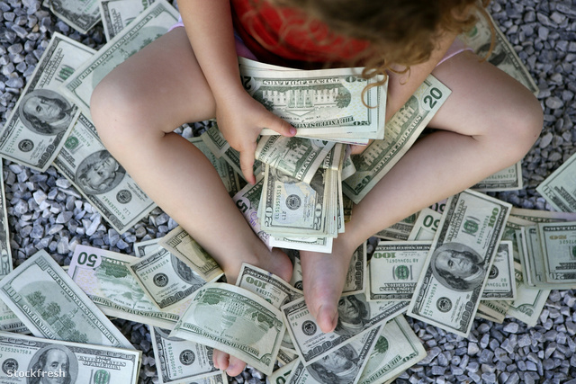 stockfresh 312186 toddler-girl-with-lots-of-dollar-notes sizeM