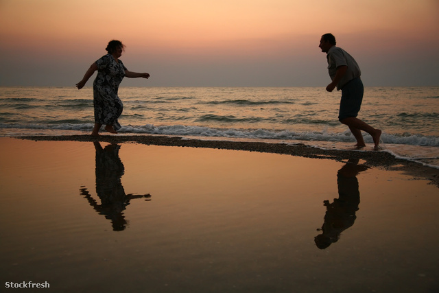stockfresh 647819 grandfather-with-grandmother-on-sunset-at-sea-
