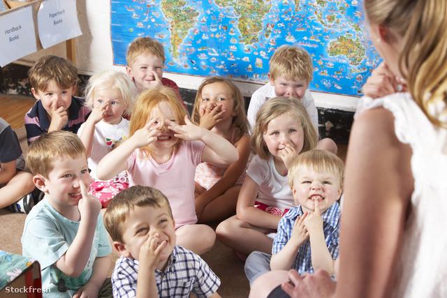 stockfresh 95960 montessoripre-school-class-listening-to-teacher