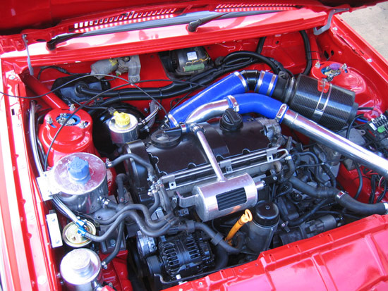 A PD TDI engine put in the engine bay of an old Scirocco. The PD engine is quite popular among tuners because its crankshaft housing is very strong