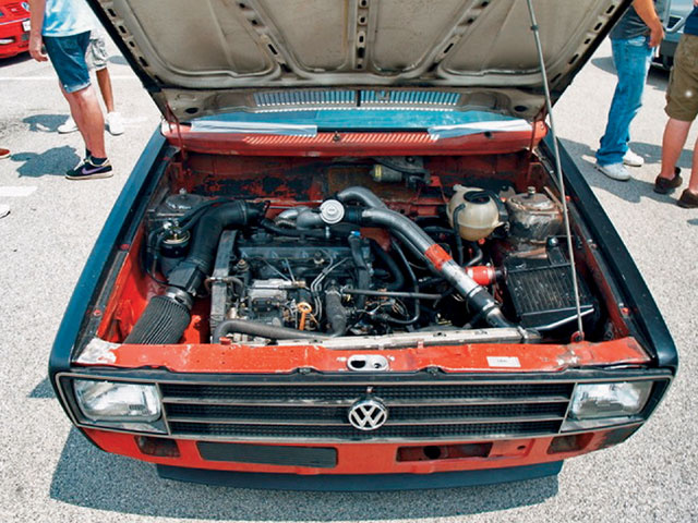 Home-tuned engine bay of a Brazilian VW Caddy. At least the filter doesn't suck hot air