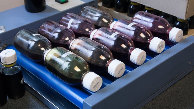 The bottles are turned on rollers, to have the samples mix evenly
