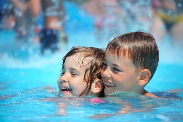 stockfresh id646009 smiling-boy-and-little-girl-swimming-in-pool