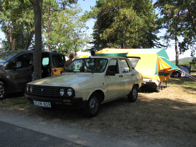 A Romanian made Dacia (a licensed version of the Reanult 12) with a tent-trailer