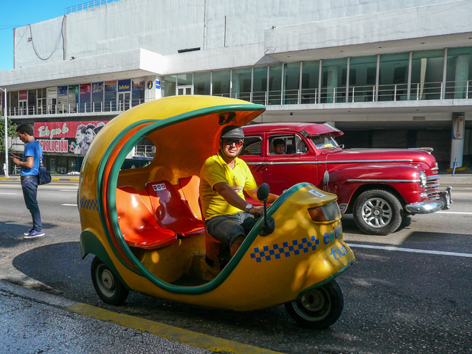 A shipment of Vespa Apes must have lost its way and arrived at Cuba by mistake, because the city is full of such three-seat moped taxis. They take to your medium distance destination at a lower price than the ordinary taxis, and they're a lot of fun.