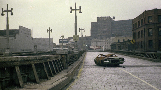West Side Highway abandoned with burned out 1970s Camaro. 1975