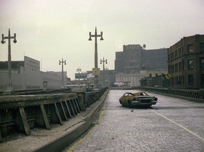 A derelict Camaro on the West Side Highway in 1975
