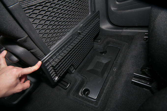One of the floor compartments is taken up by the JBL audio