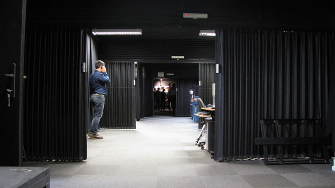 The test bench is located at the far end of a 25 m black corridor. Instruments and gauges occupy the other end of the corridor