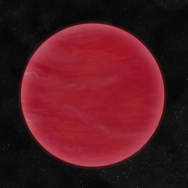 """Fantáziarajz az ULAS J222711-004547 katalógusjelű, most felfedezett barna törpéről, melynek légkörét egy vastag, főleg szilikátok porából álló felhőréteg dominálja. Ennek következtében a színe extrém vörös, megkülönböztetve ezzel a """"normál"""" barna törpéktől."""