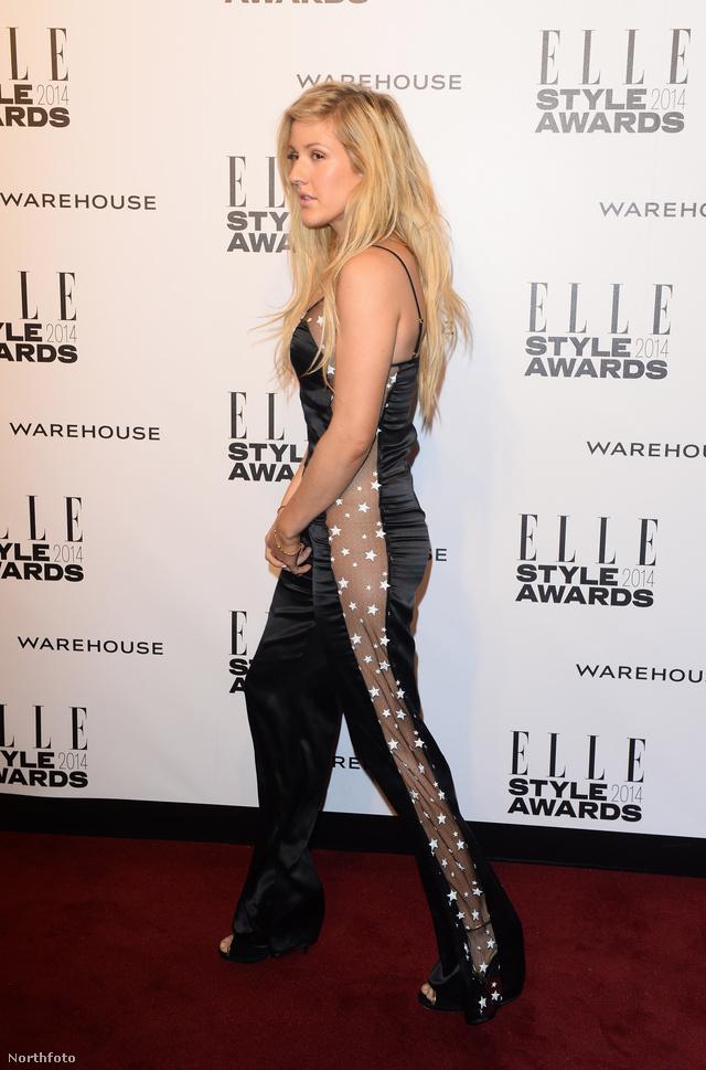 Ellie Goulding Matthew Willimson ruhában menekül a fotósok elől.