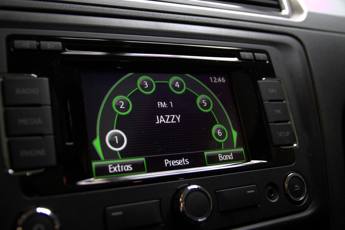Rotary program selector for the radio. Smartphone convenience in a car