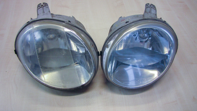 Matiz headlamps. The one on the right has been polished out. The middle section of the left-side lamp shows the way both headlights used to be