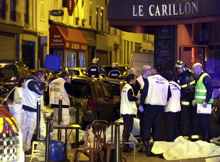Helyszínelők vizsgálják át az éttermeket a lövöldözés helyszínén.