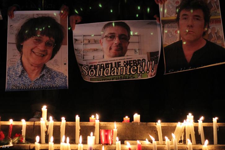 Gyertyák az áldozatok fotói előtt a belgiumi Gentben