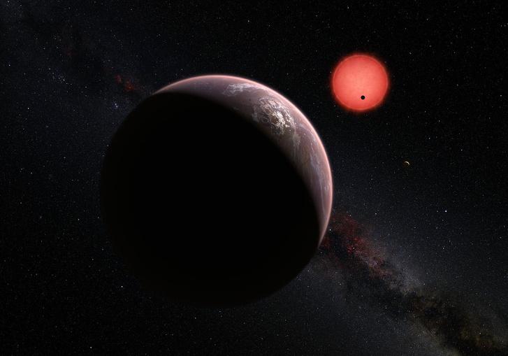 Művészi koncepció egy exobolygóról, amely egy vörös törpe csillag körül kering.