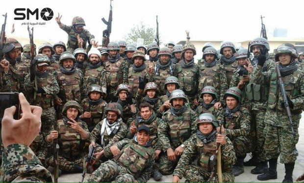 Ezen a szíriai hírügynökség által kiadott képen Iránból toborzott afgán katonák láthatók Szíriában