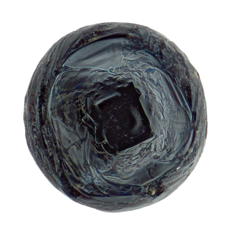 Porfirikus mikrometeorit, az olivinkristályokat olvadt üveg veszi körbe.